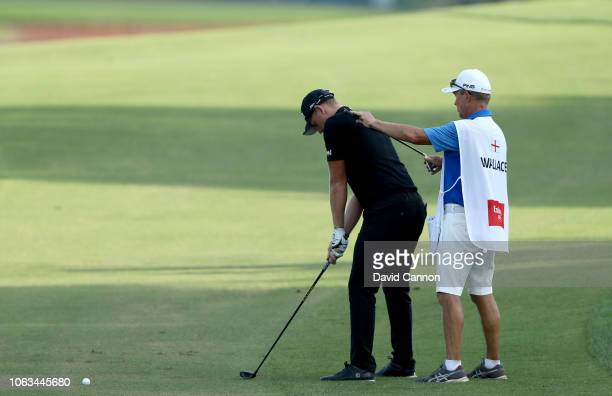 Matt Wallace of England prepares to play his second shot on the par 5 18th hole with the help of his caddie Dave McNeilly during the final round of...