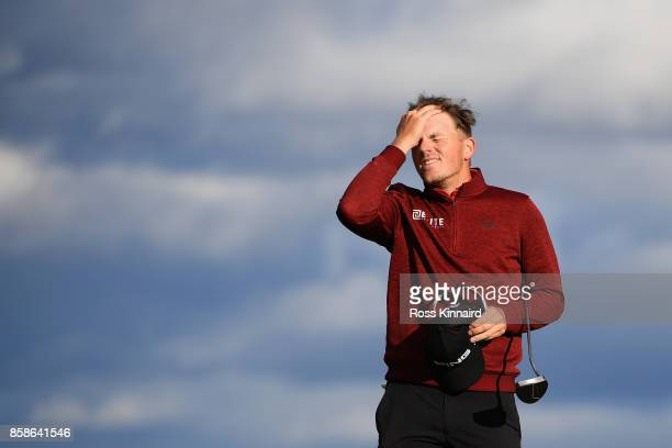 Matt Wallace of England reacts after he finishes his round on the 18th hole during day three of the 2017 Alfred Dunhill Championship at Kingsbarns on...