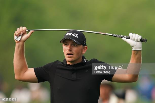 Matt Wallace of England reacts after the plays a shot during the final round of the 2018 Volvo China Open at Topwin Golf and Country Club on April 29...