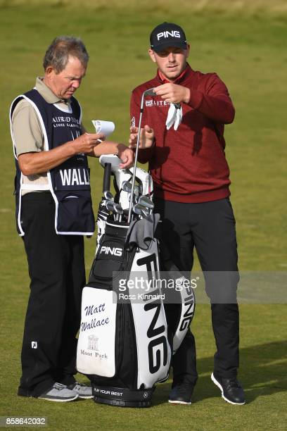 Matt Wallace of England speaks with his caddie on the 18th fairway during day three of the 2017 Alfred Dunhill Championship at Kingsbarns on October...