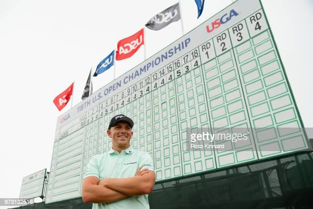 Matt Wallace of England stands in front of the leaderboard during a practice round prior to the 2018 US Open at Shinnecock Hills Golf Club on June 13...