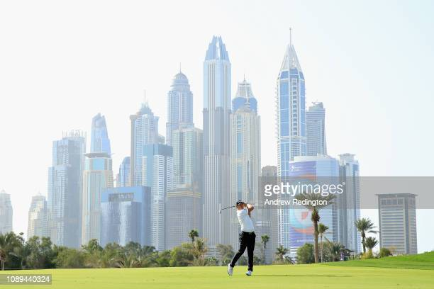 Matt Wallace of England takes his second shot on hole thirteen during Day Three of the Omega Dubai Desert Classic at Emirates Golf Club on January 26...