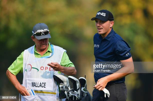 Matt Wallace of England talks with caddie Dave McNeilly during day two of the Italian Open at Golf Club Milano Parco Reale di Monza on October 13...