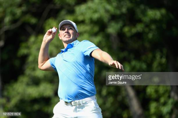 Matt Wallace of England throws a ball into the crowd on the 14th hole during the third round of the 2018 PGA Championship at Bellerive Country Club...