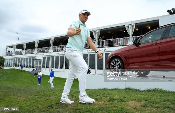 Matt Wallace of England walks off the 18th hole during the fourth round of the BMW International Open at Golf Club Gut Larchenhof on June 24 2018 in...