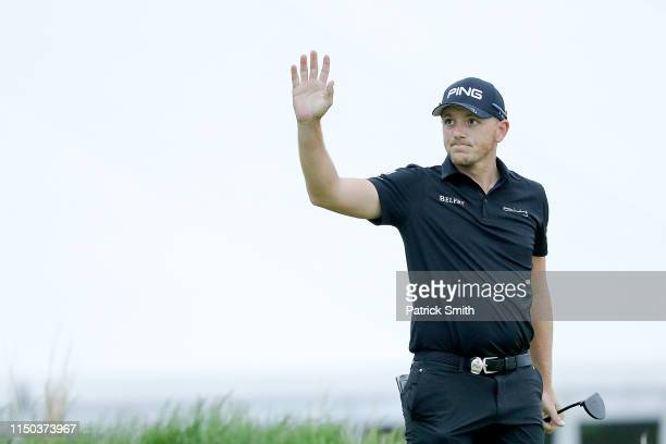 Matt Wallace of England waves to the crowd on the 18th green during the final round of the 2019 PGA Championship at the Bethpage Black course on May...