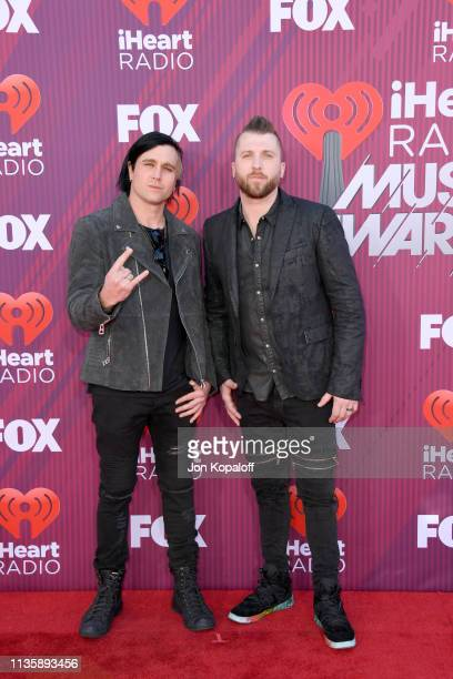 Matt Walst and Neil Sanderson of Three Days Grace attend the 2019 iHeartRadio Music Awards which broadcasted live on FOX at Microsoft Theater on...