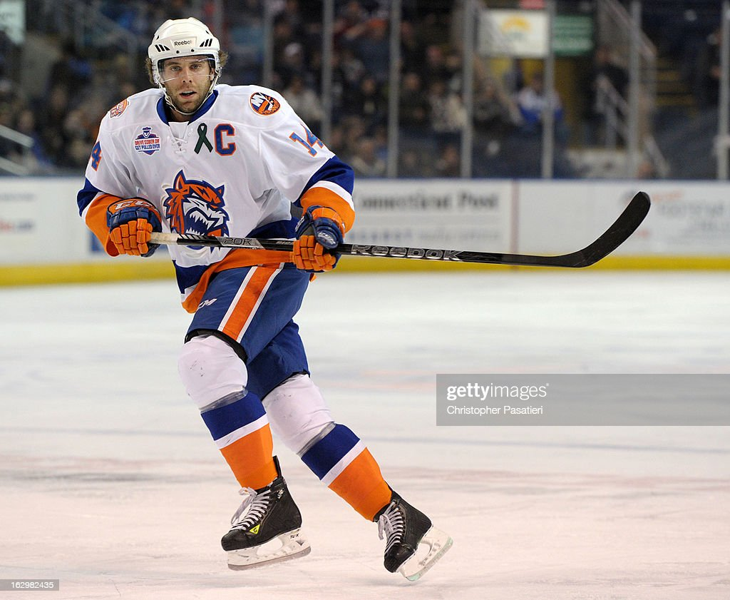 Matt Watkins #14 of the Bridgeport Sound Tigers skates during an American Hockey League game against the Adirondack Phantoms on March 2, 2013 at the Webster Bank Arena at Harbor Yard in Bridgeport, Connecticut.