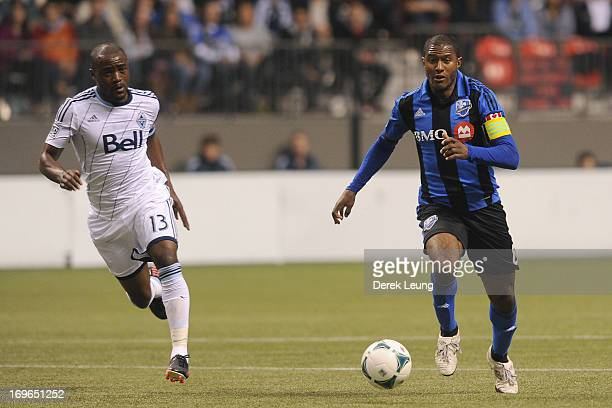 Matt Watson of the Montreal Impact is pursued by Nigel ReoCoker of the Vancouver Whitecaps during the finals of the Amway Canadian Championship at BC...