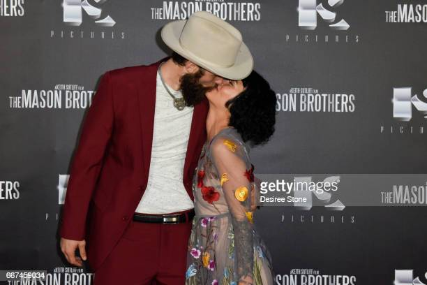 """Matt Webb and Julia Fae attend the premiere of """"The Mason Brothers"""" at the Egyptian Theatre on April 11, 2017 in Hollywood, California."""