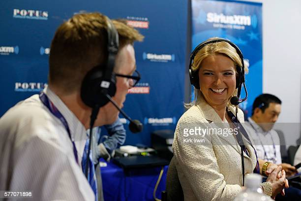 Matt Welch editor of Reason Magazine and Christine Romans of CNN talk while sitting in on Stand Up with Pete Dominick on SiriusXM during a taping at...