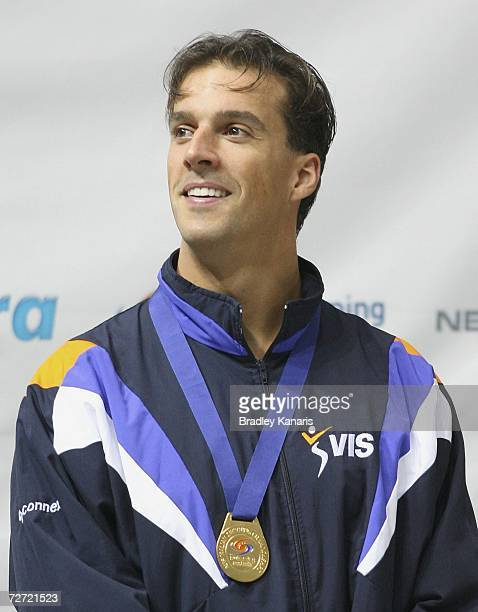 Matt Welsh is presented with the gold medal after winning the Men's 100m Backstroke final on day three of the Australian Championships at Chandler...