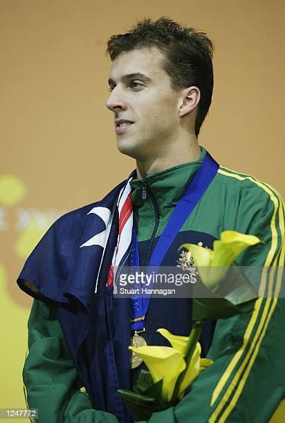 August 3: Matt Welsh of Australia celebrates after winning gold in the Men's 100M Backstroke swimming Final from the Manchester Aquatics centre...