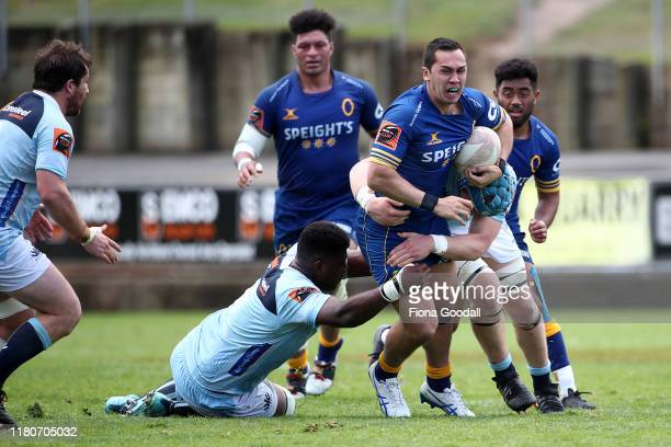 Matt Whaanga of Otago is tackled during the round 10 Mitre 10 Cup match between Northland and Otago at Semenoff Stadium on October 13 2019 in...