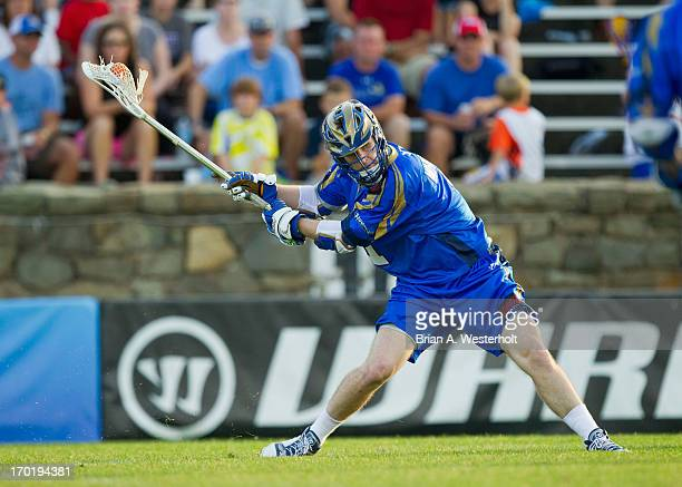 Matt White of the Charlotte Hounds winds up to take a shot on goal against the Ohio Machine at American Legion Memorial Stadium on June 8 2013 in...