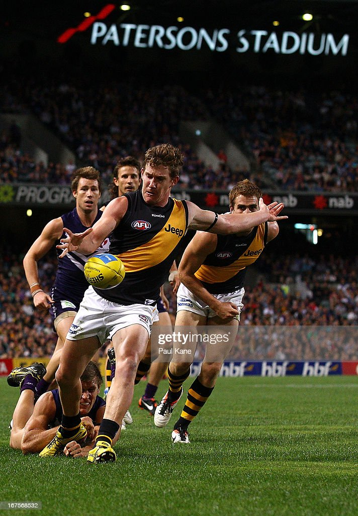 Matt White of the Tigers kicks the ball forward during the round five AFL match between the Fremantle Dockers and the Richmond Tigers at Patersons Stadium on April 26, 2013 in Perth, Australia.
