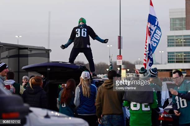 Matt Wier of Manayunk Pennsylvania lets out his war cry adorned in a luchador mask atop a SUV at Lincoln Financial Field on January 21 2018 in...