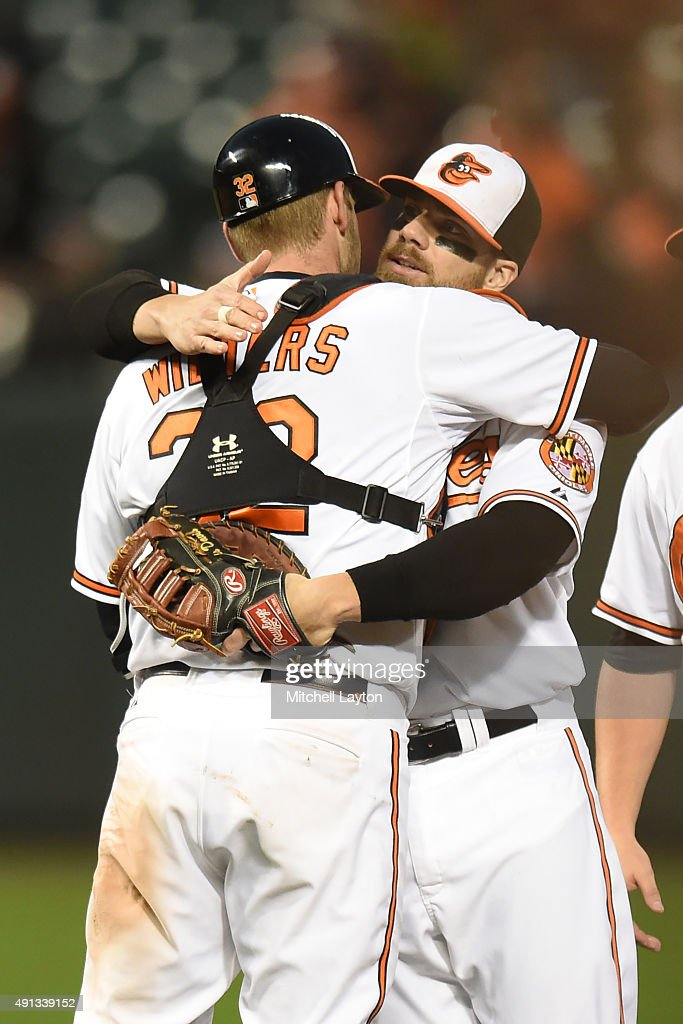 Matt Wieters #32 and Chris Davis #19 of the Baltimore Orioles celebrate win after a baseball game against the New York Yankees at Oriole Park at Camden Yards on October 4, 2015 in Baltimore, Maryland. The Orioles won 9-4.