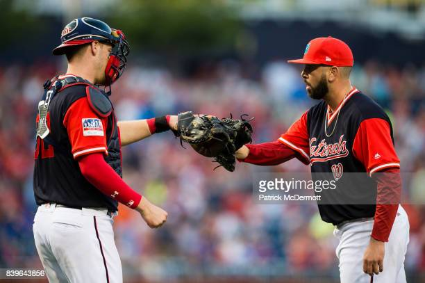 Matt Wieters and Oliver Perez of the Washington Nationals celebrate after the Nationals defeated the New York Mets 94 at Nationals Park on August 26...