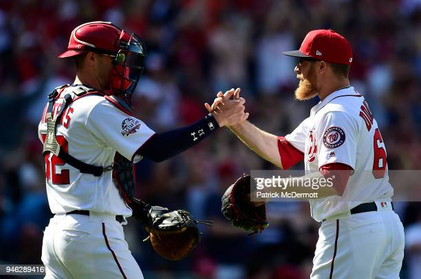 Matt Wieters and Sean Doolittle of the Washington Nationals celebrate after the Nationals defeated the Colorado Rockies 62 at Nationals Park on April...
