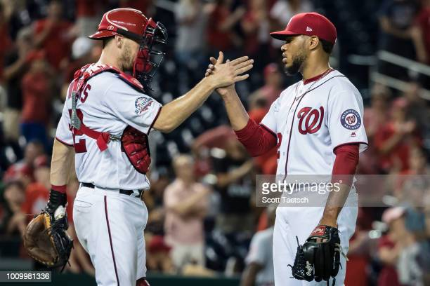 Matt Wieters celebrates with Jimmy Cordero of the Washington Nationals after the game against the Cincinnati Reds at Nationals Park on August 02 2018...