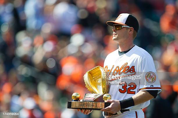 Matt Wieters of the Baltimore Orioles accepts the Golden Glove Award before the game against the Minnesota Twins at Oriole Park at Camden Yards on...