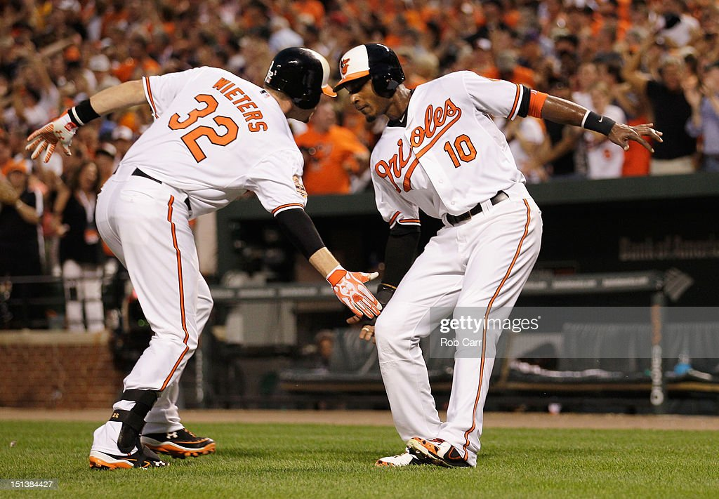 Matt Wieters #32 of the Baltimore Orioles celebrates with teammate Adam Jones #10 after hitting a three RBI home run during the first inning against the New York Yankees at Oriole Park at Camden Yards on September 6, 2012 in Baltimore, Maryland.