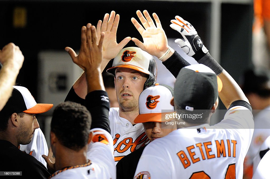 Matt Wieters #32 of the Baltimore Orioles celebrates with teammates after scoring in the seventh inning against the New York Yankees at Oriole Park at Camden Yards on September 9, 2013 in Baltimore, Maryland. Baltimore won the game 4-2.