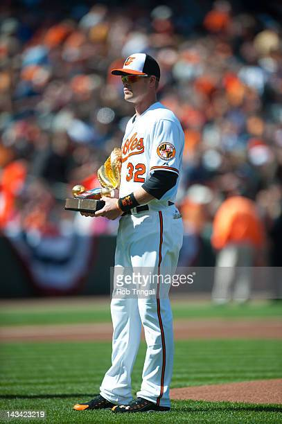 Matt Wieters of the Baltimore Orioles holds his Golden Glove Trophy before the game against the Minnesota Twins at Oriole Park at Camden Yards on...