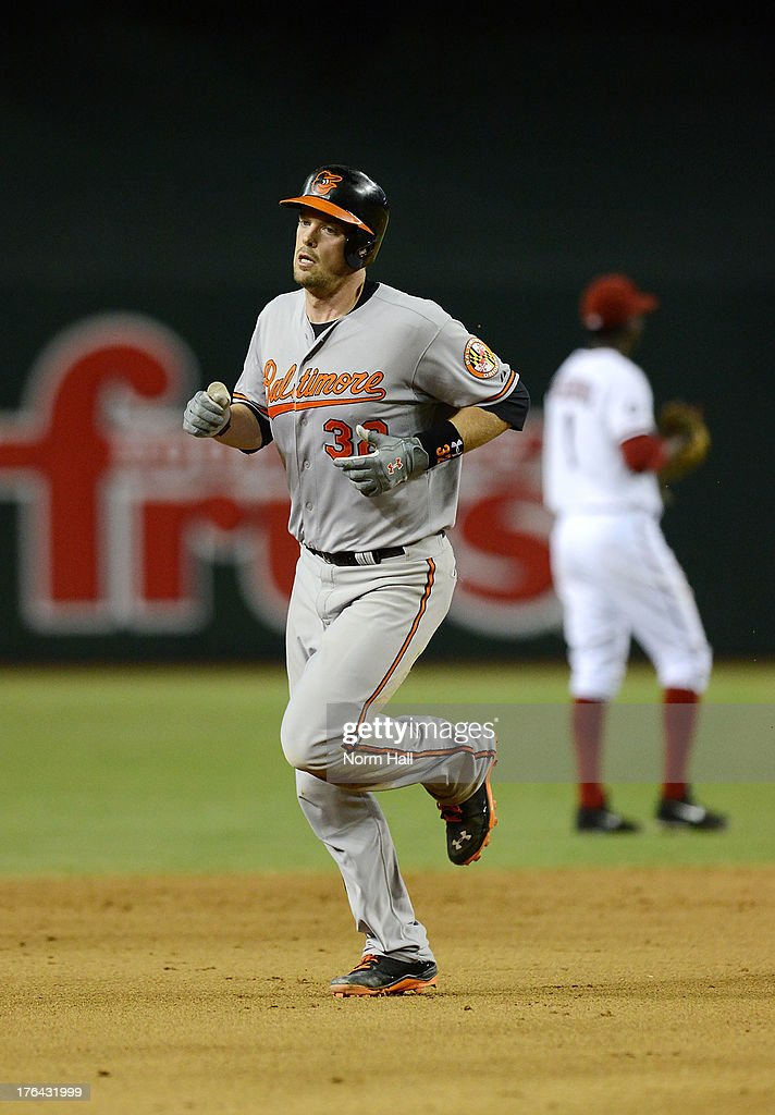 Matt Wieters #32 of the Baltimore Orioles rounds the bases after hitting a home run against the Arizona Diamondbacks at Chase Field on August 12, 2013 in Phoenix, Arizona.