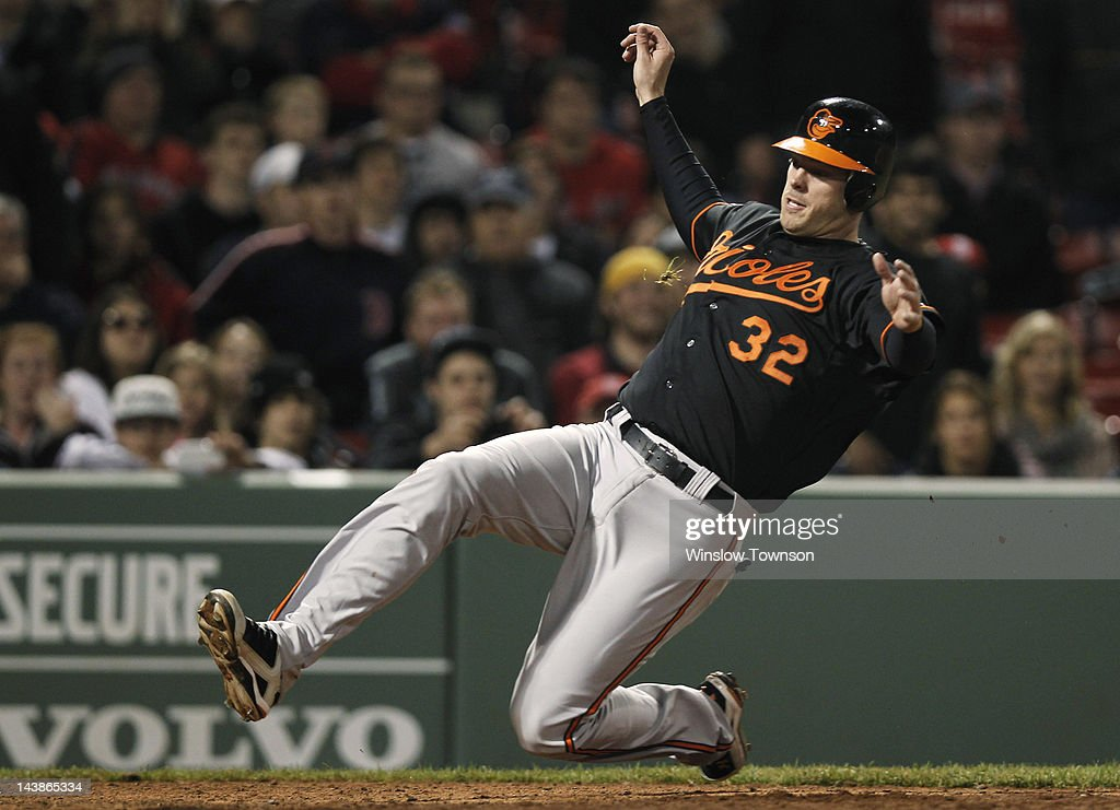 Matt Wieters #32 of the Baltimore Orioles slides home with the go ahead run against the Boston Red Sox on a hit by teammate Chris Davis #19 of the Baltimore Orioles during the thirteenth inning of the game at Fenway Park on May 4, 2012 in Boston, Massachusetts.