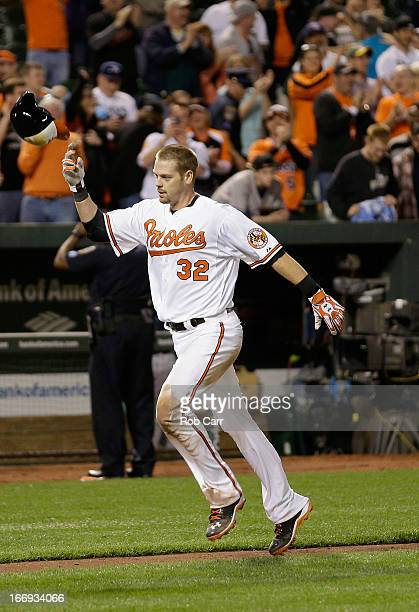 Matt Wieters of the Baltimore Orioles throws his batting helmet in the air while rounding the bases after hitting a walk off grand slam to give the...