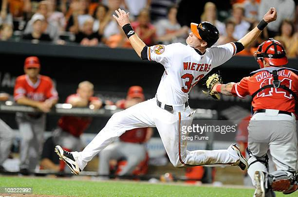 Matt Wieters of the Baltimore Orioles tries to avoid the tag of Mike Napoli of the Los Angeles Angels of Anaheim at Camden Yards on August 3 2010 in...
