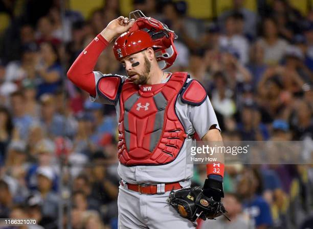 Matt Wieters of the St. Louis Cardinals reacts to a Justin Turner of the Los Angeles Dodgers double to score Max Muncy, to take a 6-0 dodger lead,...