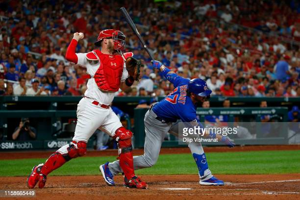 Matt Wieters of the St. Louis Cardinals throws out a runner at second base after Kris Bryant of the Chicago Cubs strike out in the sixth inning at...