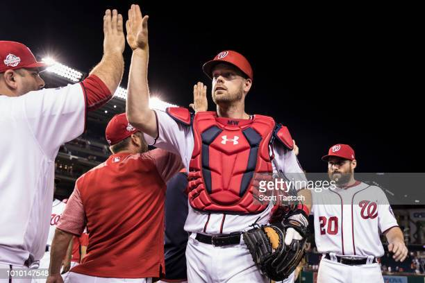 Matt Wieters of the Washington Nationals celebrates with teammates after the game against the Cincinnati Reds at Nationals Park on August 02 2018 in...