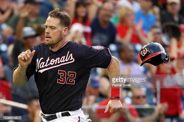 Matt Wieters of the Washington Nationals loses his helmet as he runs to score a run against the New York Mets during the first inning at Nationals...