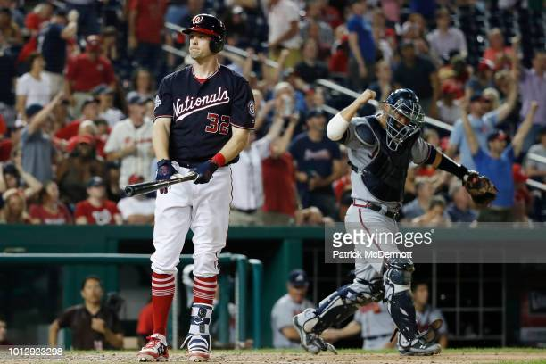 Matt Wieters of the Washington Nationals reacts after lining into a double play in the ninth inning against the Atlanta Braves during game two of a...