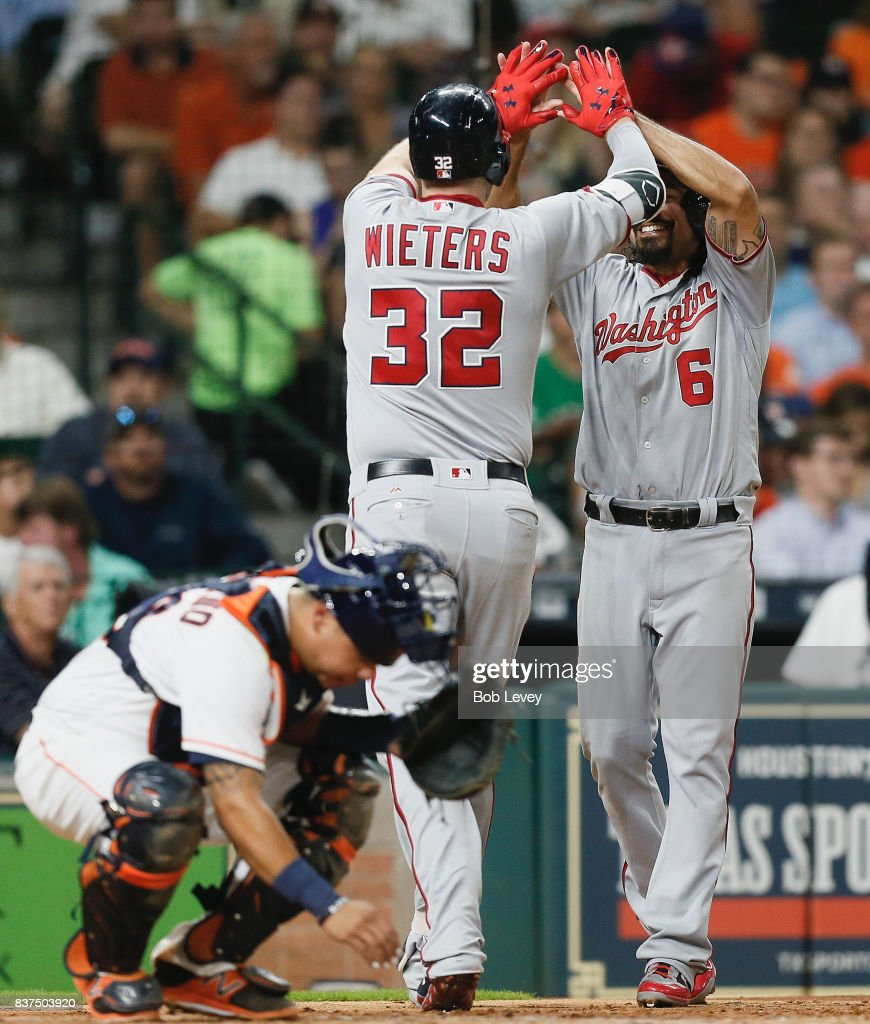 Matt Wieters #32 of the Washington Nationals receives a high five from Anthony Rendon #6 after hitting a two-run home run in the fourth inning against the Houston Astros at Minute Maid Park on August 22, 2017 in Houston, Texas.