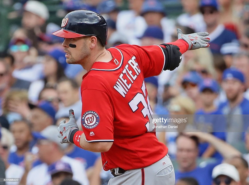 Matt Wieters #32 of the Washington Nationals runs the bases after hitting a grand slam home run in the 8th inning against the Chicago Cubs at Wrigley Field on August 6, 2017 in Chicago, Illinois.