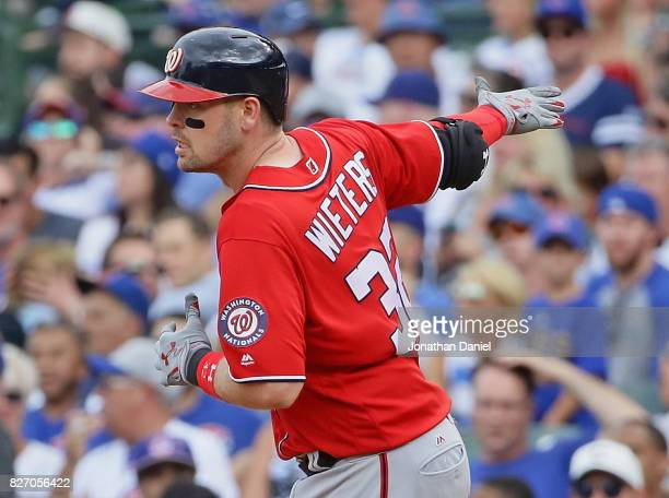 Matt Wieters of the Washington Nationals runs the bases after hitting a grand slam home run in the 8th inning against the Chicago Cubs at Wrigley...