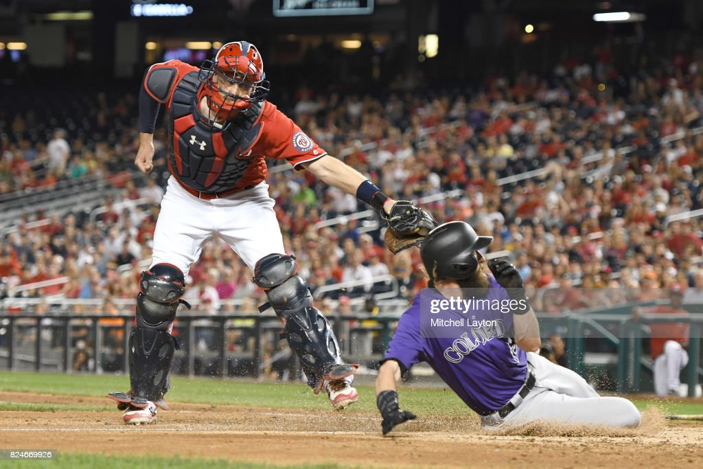Matt Wieters #32 of the Washington Nationals tags out Charlie Blackmon #19 of the Colorado Rockies trying to advance on Gerardo Parra #8 (not pictured) single in the fifth inning during game two of a doubleheader at Nationals Park on July 30, 2017 in Washington, DC.