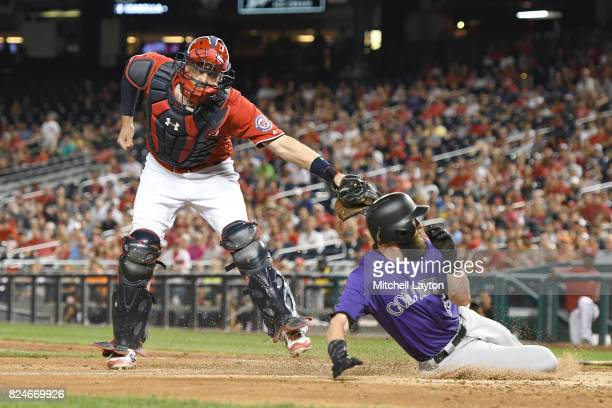 Matt Wieters of the Washington Nationals tags out Charlie Blackmon of the Colorado Rockies trying to advance on Gerardo Parra single in the fifth...