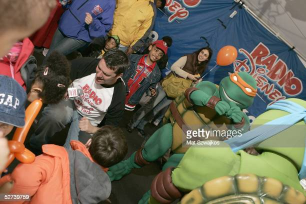 Matt Wilder entertains children with Teenage Mutant Ninja Turtles at the Family Festival Street Fair at the Tribeca Film Festival April 30 2005 in...