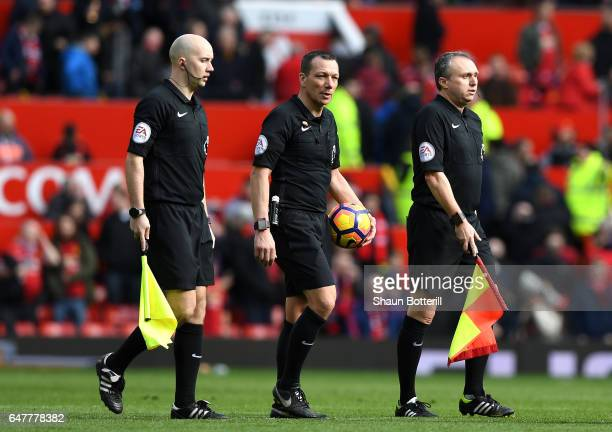 Matt Wilkes assistant referee Kevin Friend referee and Darren Cann assistant referee walk off at half time during the Premier League match between...