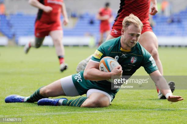 Matt Williams of London Irish goes over to score a try during the Greene King IPA Championship match between London Irish and Hartpury RFC at...