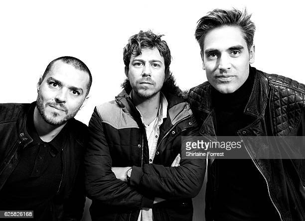 Matt Willis James Bourne and Charlie Simpson of Busted pose backstage after meeting fans and signing copies of their new album 'Night Driver' at HMV...