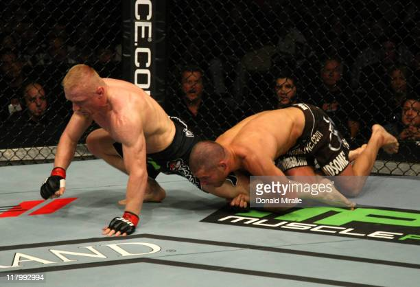 Matt Wiman attempts to take down Dennis SIver during a lightweight bout at UFC 132 at MGM Grand Garden Arena on July 2, 2011 in Las Vegas, Nevada.