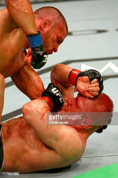 Matt Wiman prepares to deliver an elbow strike against Dennis Siver on the ground during a lightweight bout at UFC 132 at MGM Grand Garden Arena on...