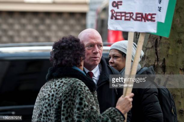 Matt Wrack head of the Fire Brigade's Union stops to talk to protestors on his way into the inquiry on January 27 2020 in London England The Grenfell...